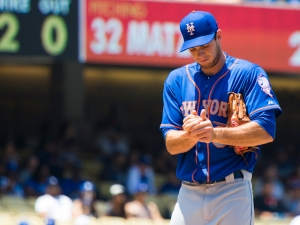 Steven Matz rubs a new baseball