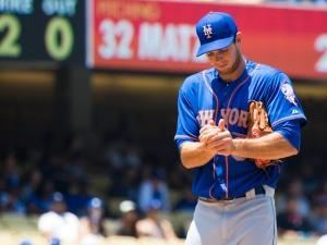 Steven Matz rubs a new baseball